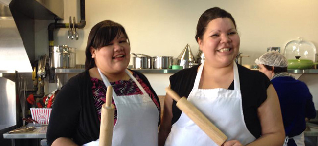 two aboriginal women in aprons