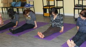 group of women doing yoga on floor